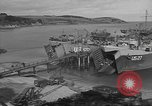Image of U.S. Army Vehicles being loaded on LSTs before D-Day Falmouth England, 1944, second 8 stock footage video 65675060406