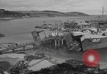 Image of U.S. Army Vehicles being loaded on LSTs before D-Day Falmouth England, 1944, second 10 stock footage video 65675060406