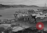 Image of U.S. Army Vehicles being loaded on LSTs before D-Day Falmouth England, 1944, second 12 stock footage video 65675060406