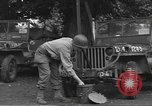 Image of United States soldiers install wire cutters on jeeps England, 1944, second 4 stock footage video 65675060407
