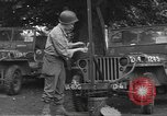 Image of United States soldiers install wire cutters on jeeps Devon England, 1944, second 5 stock footage video 65675060407