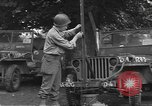 Image of United States soldiers install wire cutters on jeeps Devon England, 1944, second 6 stock footage video 65675060407