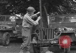 Image of United States soldiers install wire cutters on jeeps England, 1944, second 7 stock footage video 65675060407