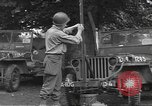 Image of United States soldiers install wire cutters on jeeps Dorchester England, 1944, second 8 stock footage video 65675060407