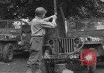 Image of United States soldiers install wire cutters on jeeps Dorchester England, 1944, second 9 stock footage video 65675060407
