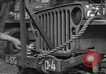 Image of United States soldiers install wire cutters on jeeps Devon England, 1944, second 18 stock footage video 65675060407