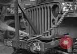 Image of United States soldiers install wire cutters on jeeps England, 1944, second 19 stock footage video 65675060407