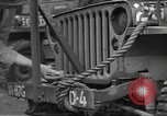 Image of United States soldiers install wire cutters on jeeps Devon England, 1944, second 20 stock footage video 65675060407