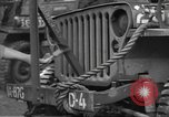 Image of United States soldiers install wire cutters on jeeps Devon England, 1944, second 21 stock footage video 65675060407