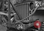 Image of United States soldiers install wire cutters on jeeps Devon England, 1944, second 22 stock footage video 65675060407