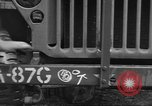 Image of United States soldiers install wire cutters on jeeps Devon England, 1944, second 27 stock footage video 65675060407