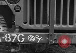 Image of United States soldiers install wire cutters on jeeps Devon England, 1944, second 28 stock footage video 65675060407