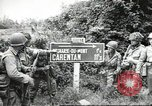 Image of United States troops greeted by French civilians Sainte-Marie-du-Mont France, 1944, second 1 stock footage video 65675060425