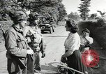 Image of United States troops greeted by French civilians Sainte-Marie-du-Mont France, 1944, second 6 stock footage video 65675060425