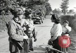 Image of United States troops greeted by French civilians Sainte-Marie-du-Mont France, 1944, second 7 stock footage video 65675060425