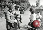 Image of United States troops greeted by French civilians Sainte-Marie-du-Mont France, 1944, second 8 stock footage video 65675060425