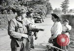 Image of United States troops greeted by French civilians Sainte-Marie-du-Mont France, 1944, second 10 stock footage video 65675060425