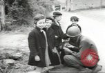 Image of United States troops greeted by French civilians Sainte-Marie-du-Mont France, 1944, second 12 stock footage video 65675060425