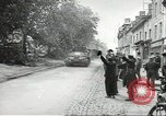 Image of American soldiers enter Sainte-Mere-Eglise in World War II Normandy France, 1944, second 5 stock footage video 65675060426