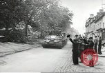 Image of American soldiers enter Sainte-Mere-Eglise in World War II Normandy France, 1944, second 7 stock footage video 65675060426