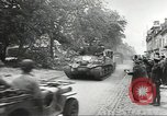 Image of American soldiers enter Sainte-Mere-Eglise in World War II Normandy France, 1944, second 8 stock footage video 65675060426