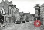 Image of American soldiers enter Sainte-Mere-Eglise in World War II Normandy France, 1944, second 9 stock footage video 65675060426