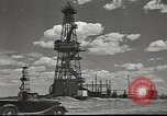 Image of Russian oil well tower Russia, 1941, second 11 stock footage video 65675060460