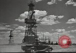 Image of Russian oil well tower Russia, 1941, second 12 stock footage video 65675060460