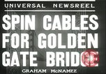 Image of cables for Golden Gate Bridge San Francisco California USA, 1935, second 3 stock footage video 65675060564