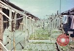 Image of homes of barracks variety Japan, 1946, second 3 stock footage video 65675060712