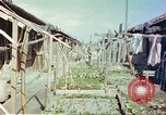 Image of homes of barracks variety Japan, 1946, second 6 stock footage video 65675060712