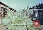 Image of homes of barracks variety Japan, 1946, second 12 stock footage video 65675060712