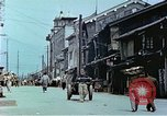 Image of damaged buildings Kobe Japan, 1946, second 2 stock footage video 65675060779