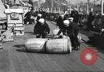 Image of sailors rolling barrels New York United States USA, 1922, second 3 stock footage video 65675060983