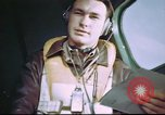 Image of B-17 crewman on interphone United Kingdom, 1943, second 2 stock footage video 65675061388