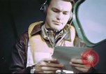 Image of B-17 crewman on interphone United Kingdom, 1943, second 6 stock footage video 65675061388