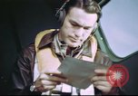 Image of B-17 crewman on interphone United Kingdom, 1943, second 7 stock footage video 65675061388