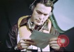 Image of B-17 crewman on interphone United Kingdom, 1943, second 8 stock footage video 65675061388