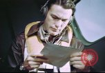 Image of B-17 crewman on interphone United Kingdom, 1943, second 9 stock footage video 65675061388