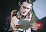 Image of B-17 crewman on interphone United Kingdom, 1943, second 10 stock footage video 65675061388