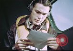 Image of B-17 crewman on interphone United Kingdom, 1943, second 11 stock footage video 65675061388