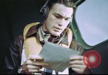Image of B-17 crewman on interphone United Kingdom, 1943, second 12 stock footage video 65675061388