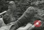 Image of dead American soldier Cassino Italy, 1944, second 10 stock footage video 65675061474