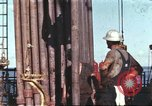 Image of offshore oil rig Atlantic Ocean, 1965, second 1 stock footage video 65675061603