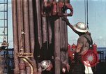 Image of offshore oil rig Atlantic Ocean, 1965, second 3 stock footage video 65675061603