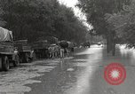 Image of flooded highway Panjao Burma, 1944, second 4 stock footage video 65675061640