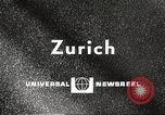 Image of huge clock Zurich Switzerland, 1967, second 2 stock footage video 65675061796