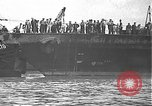 Image of USS California (BB-44) being moved to drydock Pearl Harbor Hawaii USA, 1942, second 2 stock footage video 65675061839
