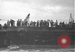 Image of USS California (BB-44) being moved to drydock Pearl Harbor Hawaii USA, 1942, second 3 stock footage video 65675061839