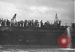 Image of USS California (BB-44) being moved to drydock Pearl Harbor Hawaii USA, 1942, second 12 stock footage video 65675061839